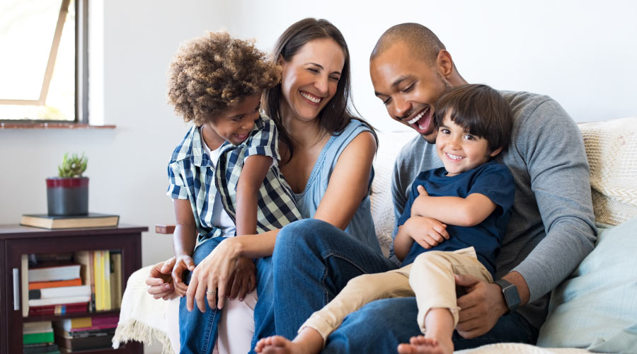 Family smiles because they enjoy the benefits of a family dentist at Taylor-Wagner Family Dentistry