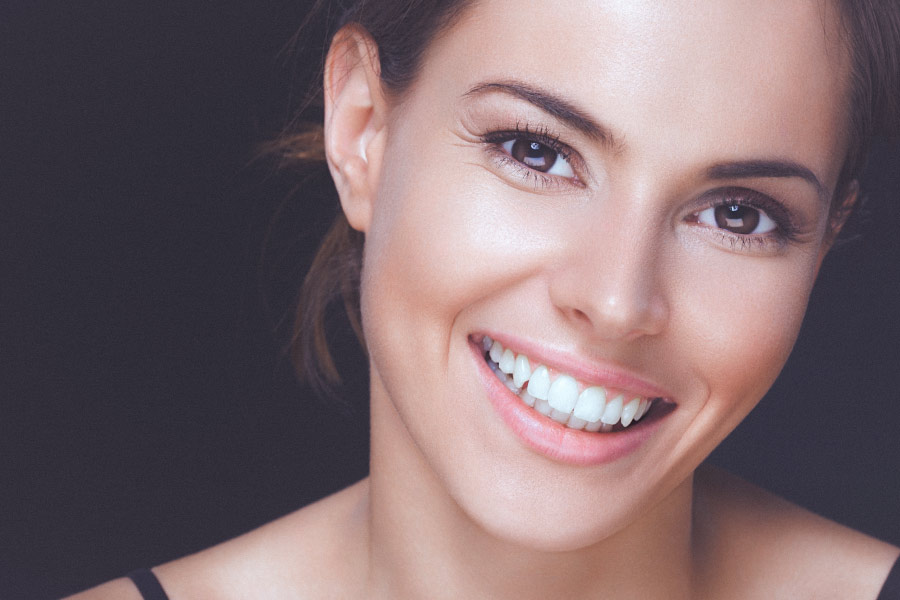 Pretty smiling brunette woman with beautiful teeth