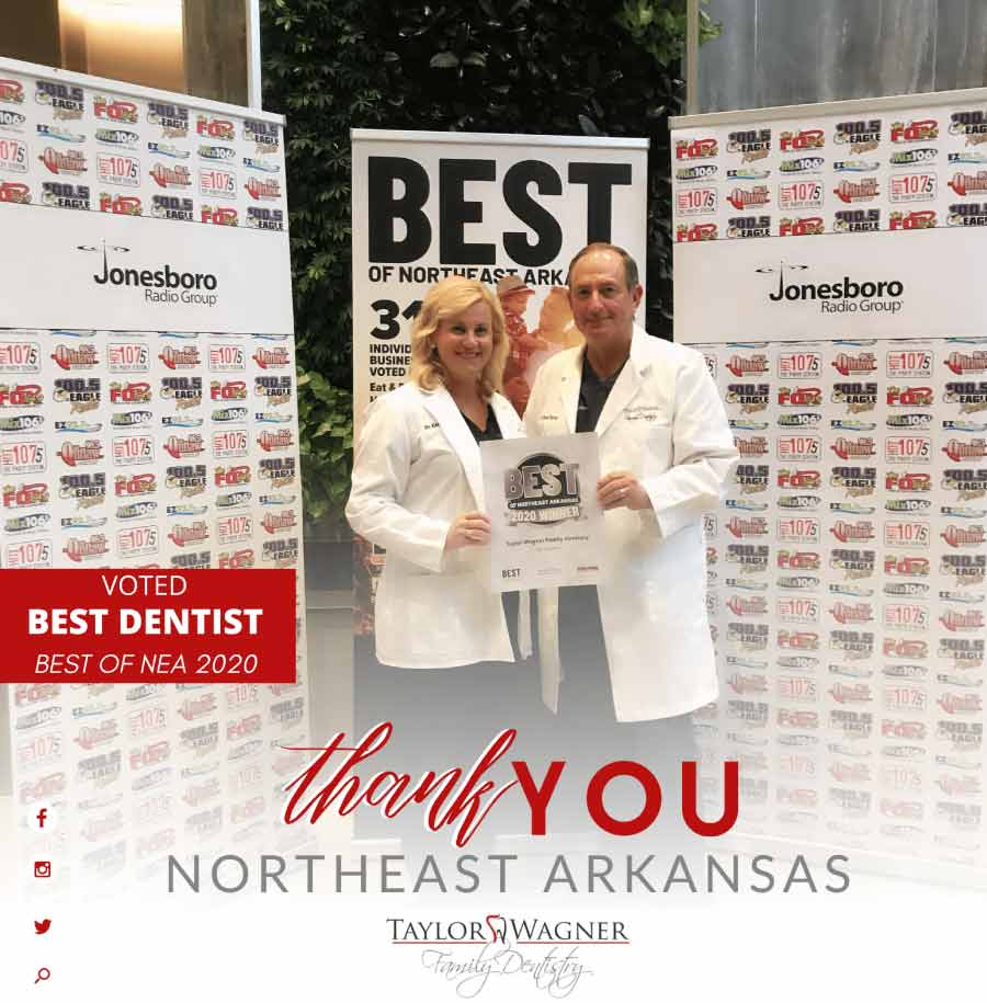 Drs. Taylor and Wagner display the Best Dentist of Northeast Arkansas award